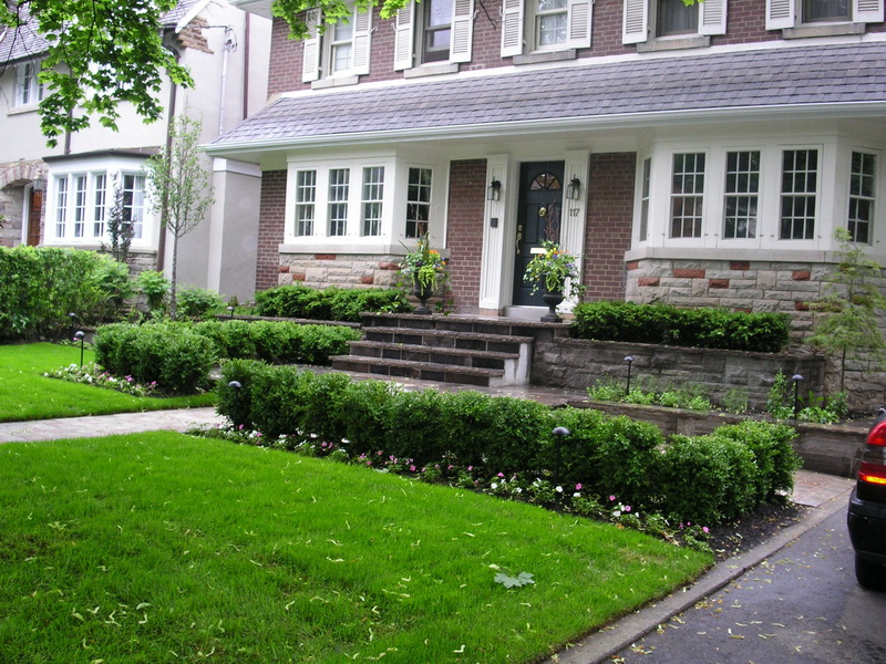 Image of a custom home design with landscaping